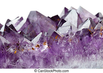 amethyst crystals - close up of semi-precious gemstone...