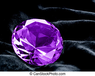 A close up on a Amethyst jewel on a dark background. Shallow DOF.