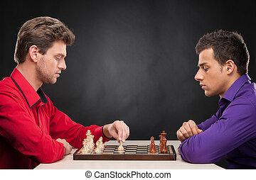 amici, gioco scacchi esegue, su, nero, fondo., serio, giovani uomini, fabbricazione, primo, spostare