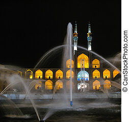 Amir Chakhmaq Complex square and fountain at night, Yazd...