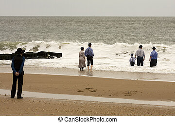Amish at Beach - Amish family enjoying the ocean on a fall...