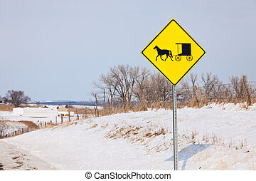 Amish carriage on the road sign