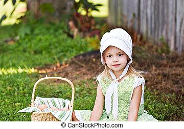 Amish Child - Little Amish girl gathering eggs