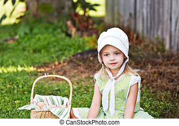 Amish Child - Little Amish girl gathering eggs