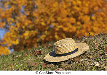 Amish Hat Laying Over Fall Leaves