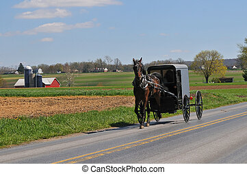 Amish horse and buggy on the road in scenic Lancaster...
