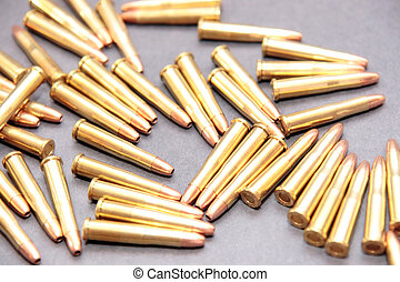 ammo 45 - ammunition all in a cluster on a dark background
