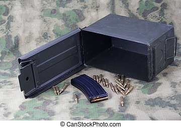 Ammo Can with ammo on camoflage background