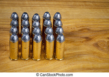 45 caliber bullets aligned on a table