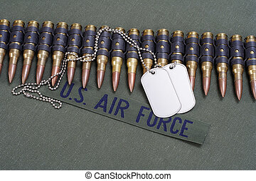 ammunition belt with dog tags on US AIR FORCE uniform