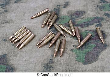Ammunition on camoflage background