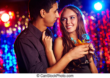 Amorous couple - Image of happy couple in the night club