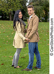 amorous couple in a park - a young, laughed liebtes couple...