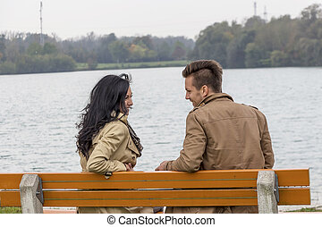 amorous couple on a park bench - a young, disappointed...