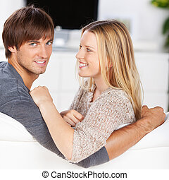 amorous couple relaxing at home