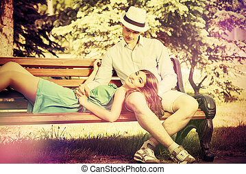 amorous couple - Romantic young people tenderly talking on a...