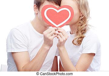 Amorous couple - Portrait of amorous young couple holding...