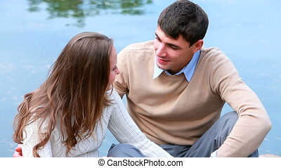 Amorous look - Zoom out of a carefree couple spending time...