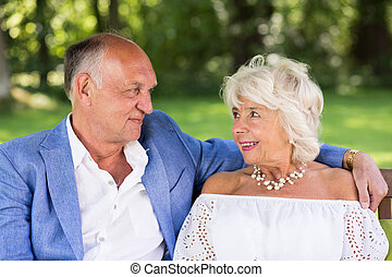 Amorous senior couple in park