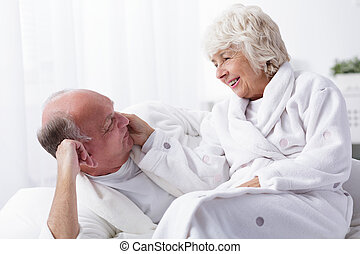 Amorous senior couple spending together pleasant morning