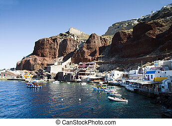 amoudi bay the fishing harbor port built into the caldera on the greek cyclades island of santorini town of oia ia on the mediterranean sea