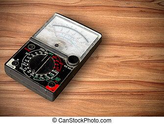 amp meter on wood blackground