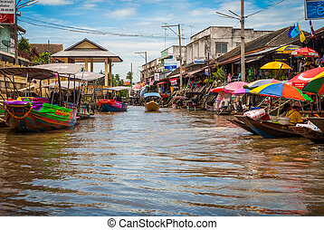 Amphawa floating market, Thailand - Many boats in the water ...