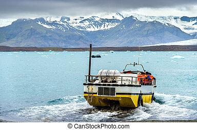 Amphibious vehicle in Jokulsarlon glacier lagoon - Iceland
