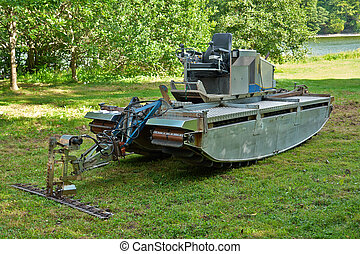 Amphibious vehicle with cutter trimmer for work in rivers...