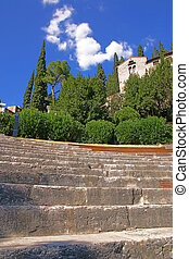 Amphitheatre of the Teatro Romano in Verona, Italy, with the Archaeological Museum in the background vertical