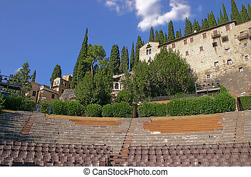 Amphitheatre of the Teatro Romano in Verona, Italy, with the Archaeological Museum in the background