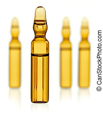 Ampoule containing yellow drug with three blurred ampoules on background