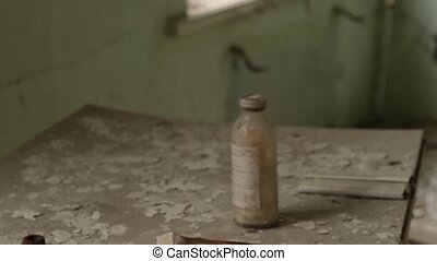 ampoules for injections lie on the table in abandoned Children Hospital in Ghost Town Pripyat, Chernobyl Exclusion Zone, Ukraine 2020