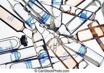 ampoules on a white background - Heap of glass ampoules on a...