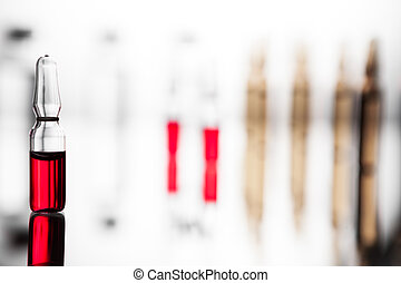 Group of ampoules with a transparent medicine in medical laboratory