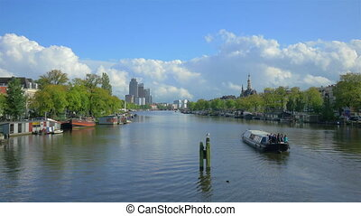 AMSTERDAM - August 25, 2014: 4k UHD. Amstel river in Amsterdam, Holland.