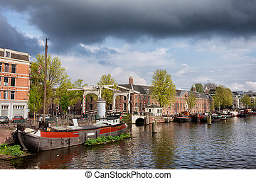 Amstel River Waterfront in Amsterdam - Boats on the Amstel...