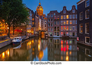 Amsterdam at night - Nightview of Nicolaaskerk in Amsterdam