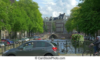 Canal in Amsterdam, Holland - AMSTERDAM - August 25, 2014:...