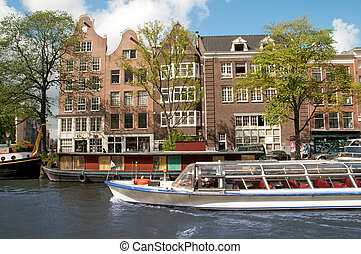 Amsterdam canal - Amsterdam Canal with many boats