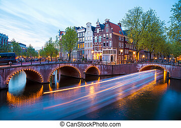 Amsterdam Canal and Light Trails of a Vessel