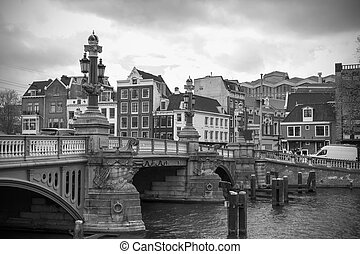 Amsterdam canals and typical houses, black and white image
