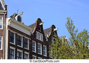Amsterdam canal houses - Typical dutch houses along...