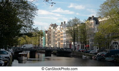 Amsterdam canal in fall colors. - Amsterdam canal in fall...