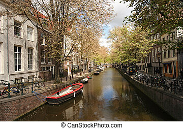 Amsterdam Canal - Quiet Amsterdam canal with small boats
