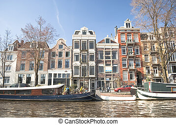 Amsterdam canals and typical houses with clear sky