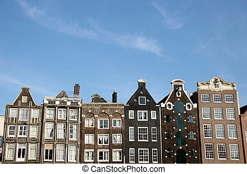 Amsterdam Houses - Buildings In Amsterdam And A Blue Sky
