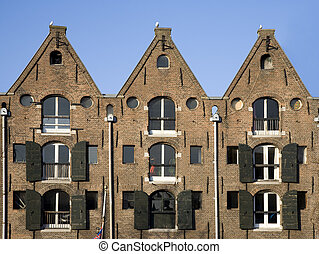 Amsterdam houses - Façade of canal houses in Amsterdam, the...