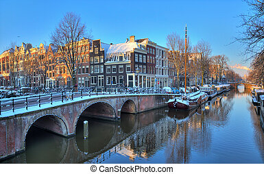 Amsterdam morning canal bridge