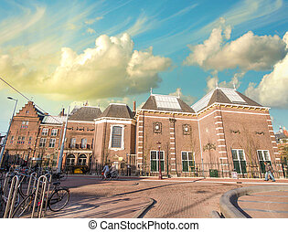 Amsterdam, Netherlands. Beautiful classic buildings with colourful sky.